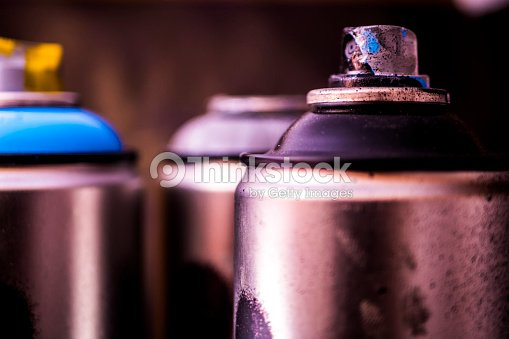 Close Up Graffiti Aerosol Spray Paint Cans Black Background Stock