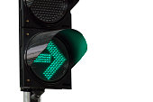 Close up  green arrow color on the traffic light on white background