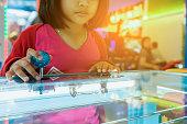 Close up hand control joystick of arcade,Vintage tone,Close up Joystick of game player