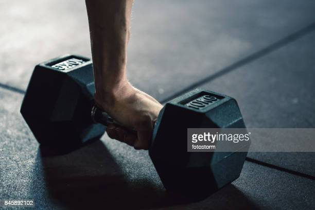 Close up hand holding dumbbell