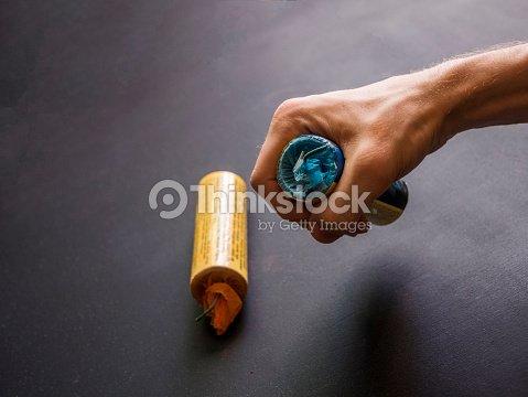 Close Up Hand Holding Firecracker Smoke Football Bomb