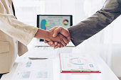 close up hand of business  people shaking hands finishing up meeting showing unity , business teamwork concept