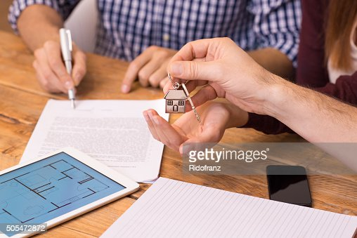 Close up hands receiving house keys : Stock Photo