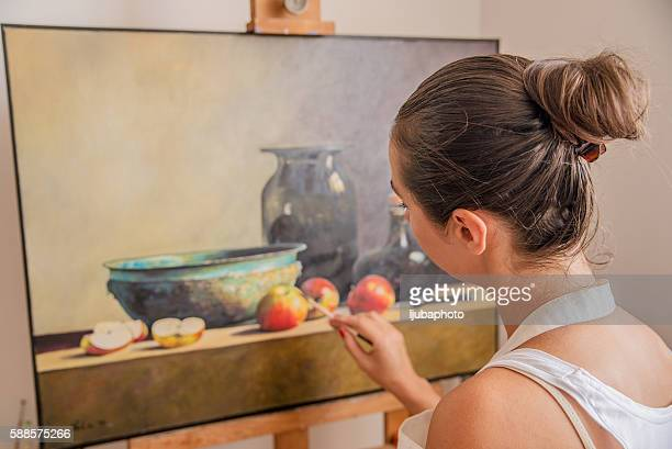 Close up image of a lovely artist busy with painting