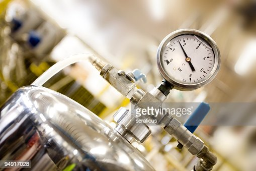 A close up image of a pressure gauge in a factory
