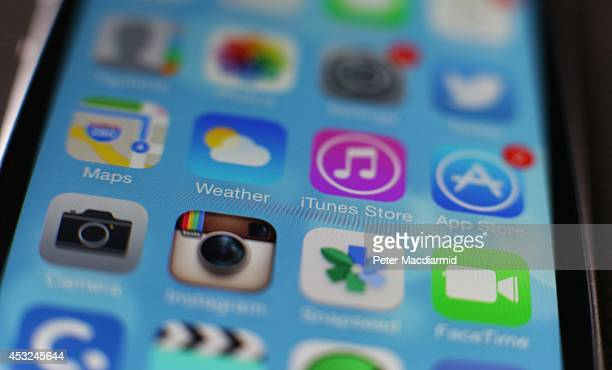 A close up image of an Apple smartphone shows home screen apps on August 6 2014 in London England Smartphone and tablet manufacturers Samsung and...
