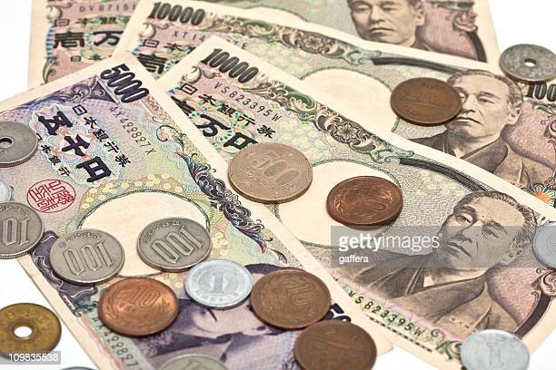 Close up image of Japanese Yen on a white background