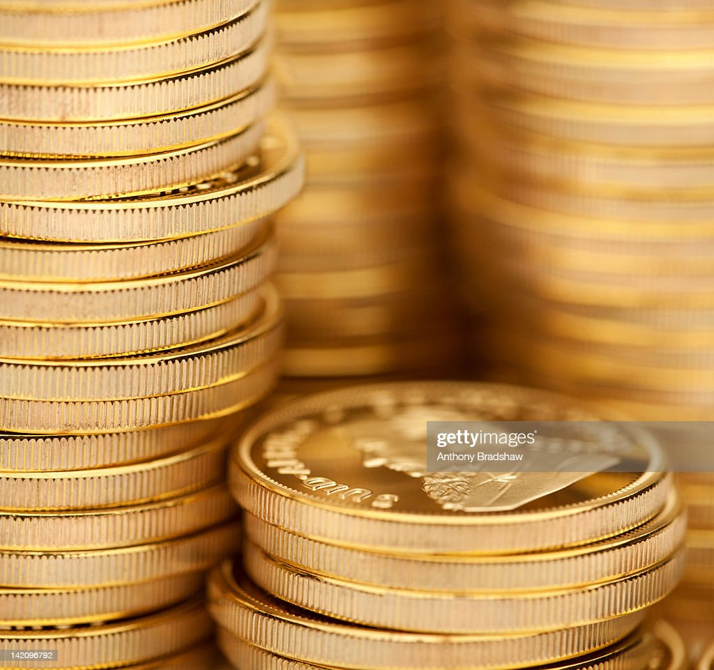 Close up image of stacks of gold coins