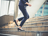 Close up legs of businesswoman walking stepping up stair in modern city, business growth, go up, success, grow up business concept