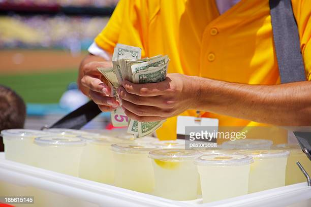 Close Up Lemonade Vendor at baseball game make change
