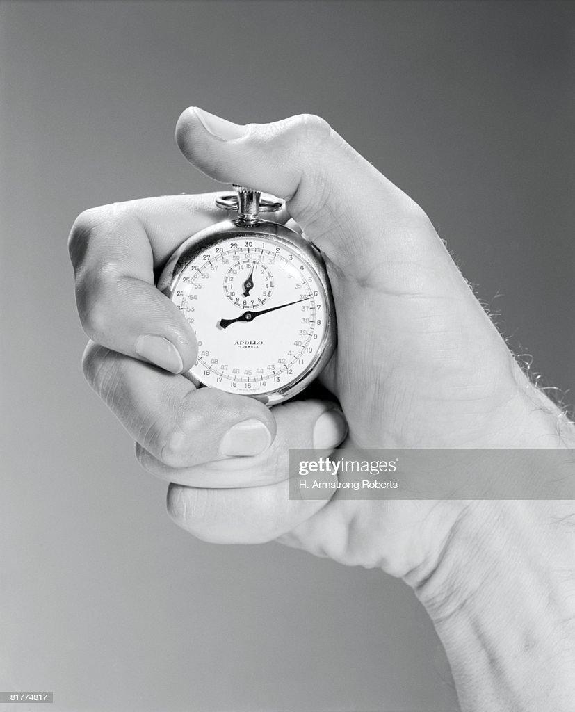 close up man's hand using stop watch indoor. : Stock Photo