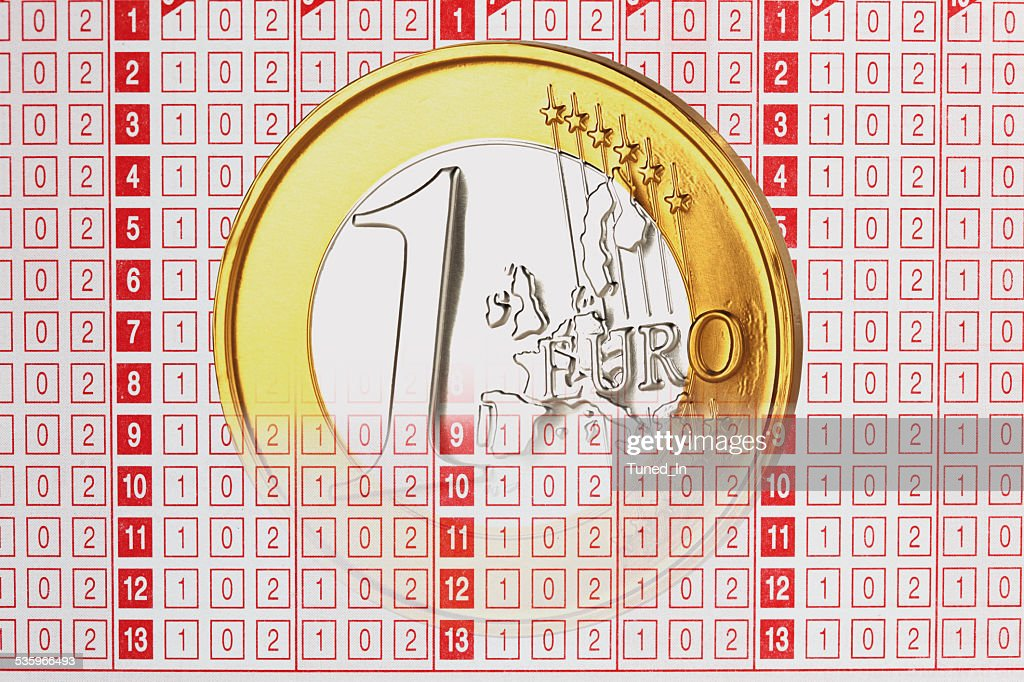 Close up of 1 euro coin on betting slip : Stock Photo