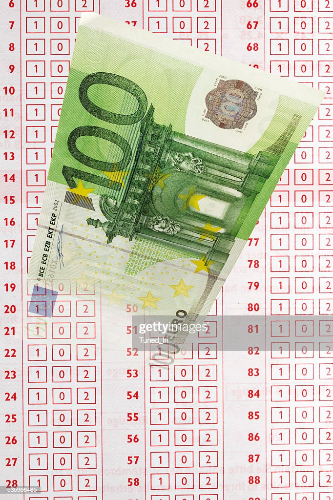Close up of 100 euro note and betting slip : Stock Photo