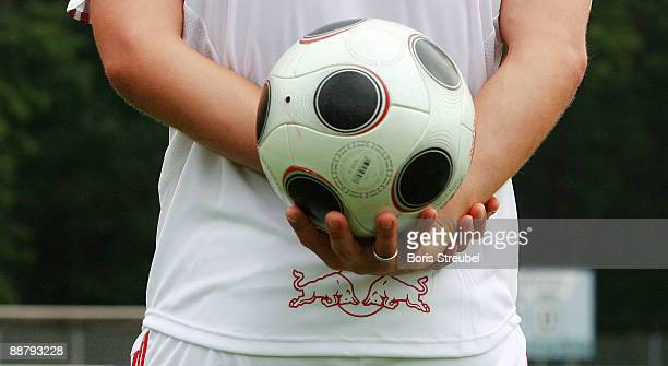 Close up of a ball and a red bull logo on a sports jersey during the RasenBallsport Leipzig eV trainings session on a training ground next to the...