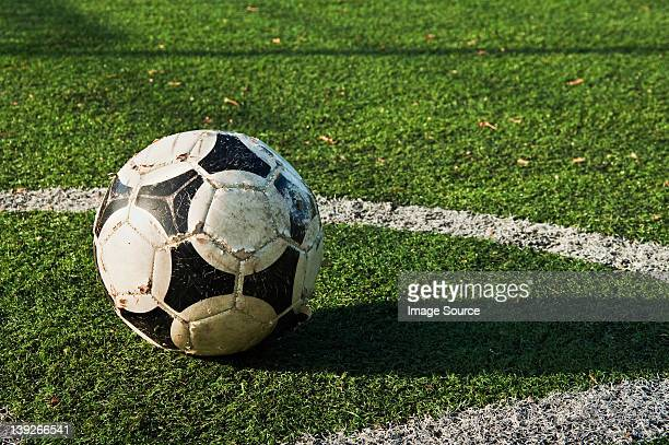 Close up of a ball on a football pitch