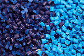 Close up of a two stacks of blue plastic polypropylene granules on a table