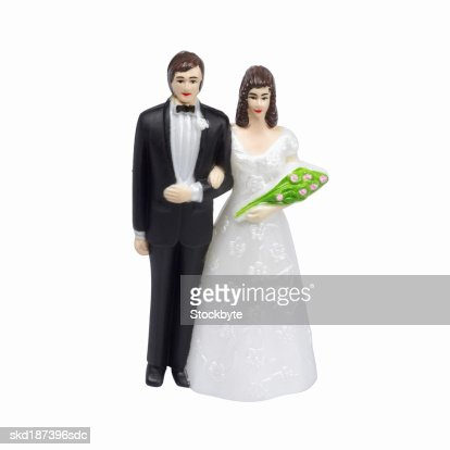 Close up of a bride and groom figurine : Stock Photo