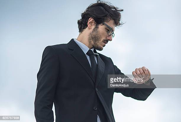 close up of a businessman checking what is the time