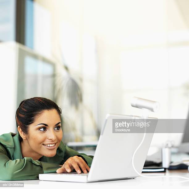 close up of a businesswoman in video conference using laptop