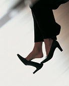 Close up of a Businesswoman Removing Her Shoes