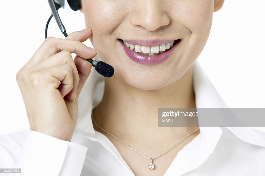 Close Up of a Businesswoman Wearing a Headset : Stock Photo