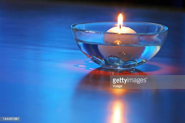 Close up of a candle in a bowl