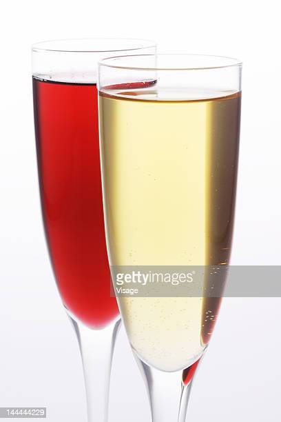 Close up of a champagne glass and wine glass