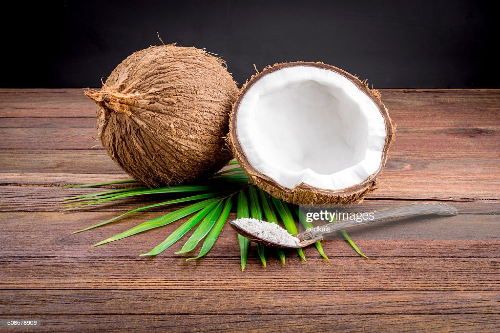 Close up of a coconut and grounded coconut flakes : Stock Photo