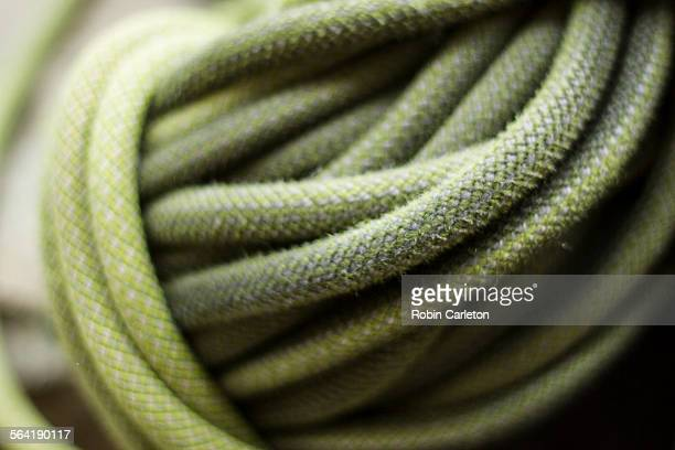 A close up of a coiled climbing rope.