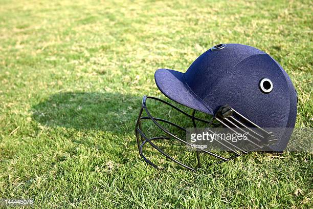 Close up of a cricket helmet lying on the cricket ground