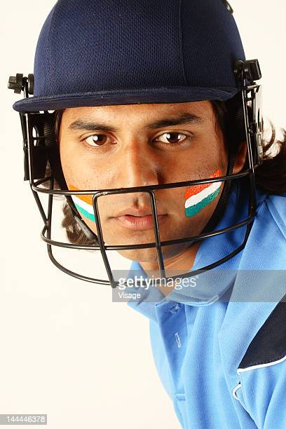 Close up of a cricketer wearing a helmet