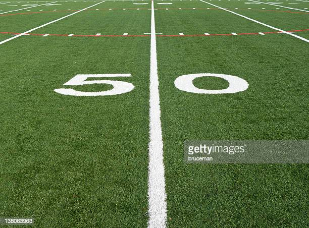 Close up of a football field at the fifty yard line