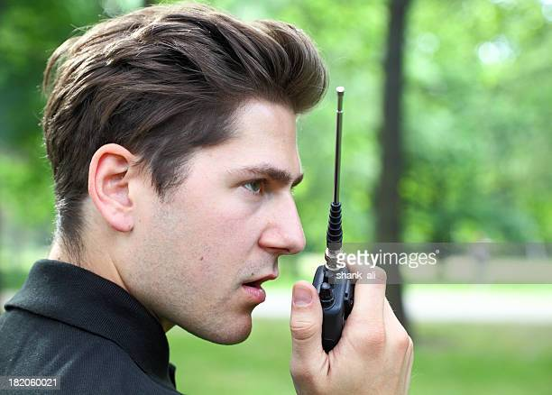 close up of a guy and walkie talkie