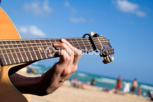 Close up of a hand playing a guitar  : Stock Photo