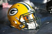 A close up of a helmet of the Green Bay Packers on the sideline during a game against the Tennessee Titans at LP Field on August 9 2014 in Nashville...