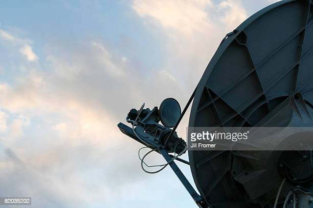 Close up of a high speed internet satellite and pretty sky with clouds.