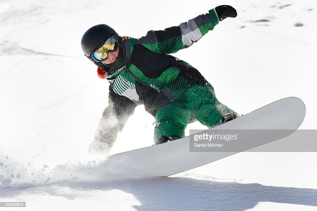 Close up of a kid on a snowboard.