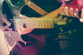 Close up of a man playing electric guitar