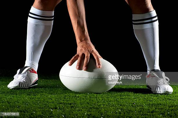 Close up of a man playing rugby ball