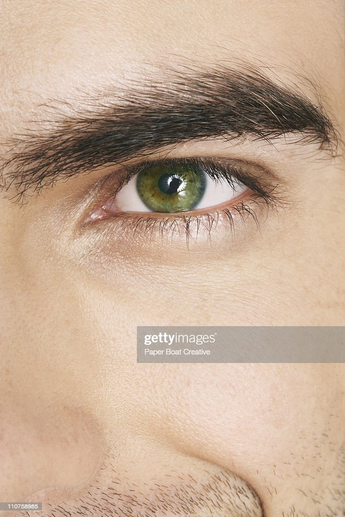 Close up of a man's green eyes : Stock Photo