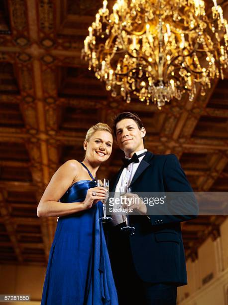 Close up of a mid adult couple holding champagne flutes