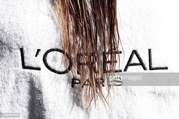 Close up of a model wearing a L'Oreal towel backstage ahead of the Julien Macdonald show during London Fashion Week Spring/Summer 2016 on September...