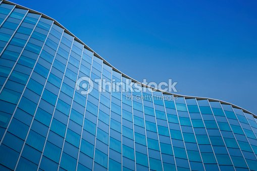 Close up of a modern architecture background - glass building exterior : Stock Photo