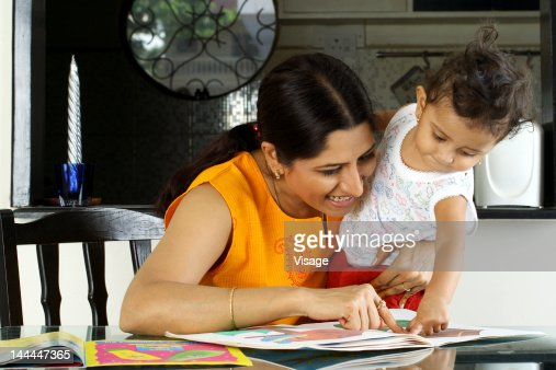 Close up of a mother teachinh her child to read : Stock Photo