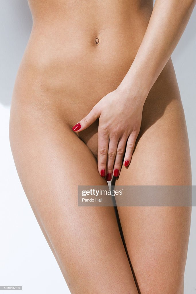 Close up of a nude woman covering herself : Stock Photo