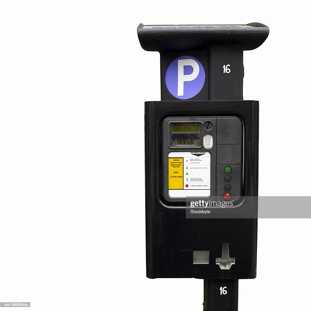 Close up of a parking meter and pay sign