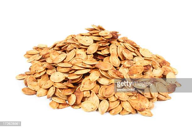 Close up of a pile of dried pumpkin seeds