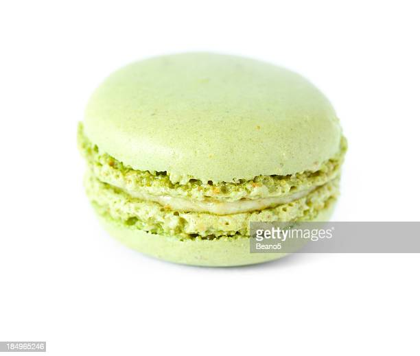Close up of a pistachio macaron