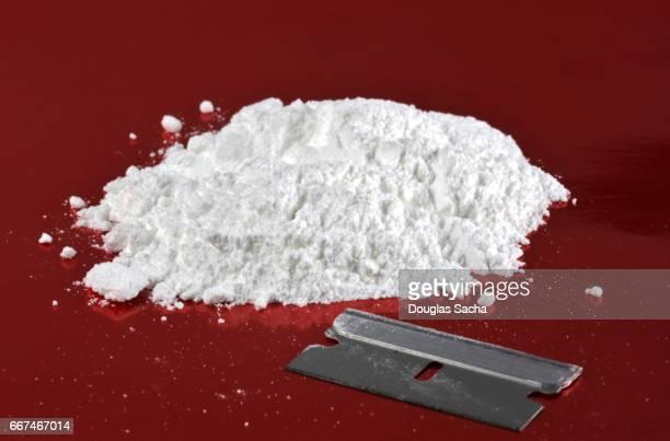 Close up of a powder drug with a razor blade