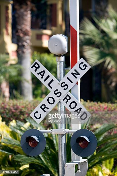 Close up of a railroad crossing lights bar and crossed safety warning sign